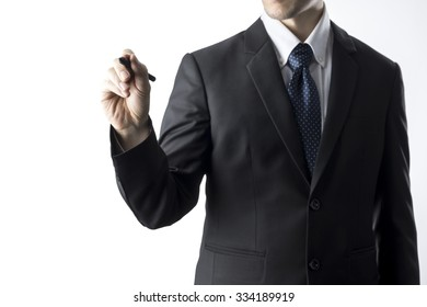 Businessman Holding Pen Writing Pose. Business Concept