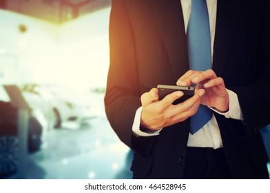 Businessman holding phone