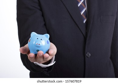 Businessman holding  Piggy bank officer put money inside for invest in the future