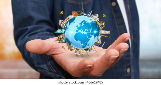 Businessman holding the planet earth surrounded by famous monuments of the world in his hands '3D rendering'