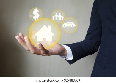 Businessman holding protect house , insurance concept
