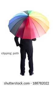 Businessman holding rainbow umbrella with clipping path