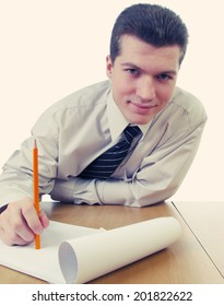 businessman holding red pencil and smiling