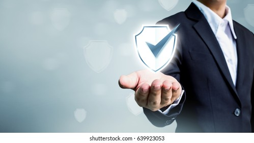 Businessman holding shield protect icon, Concept cyber security safe your data