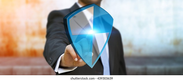 Businessman holding shield safe protection in his hand '3D rendering'