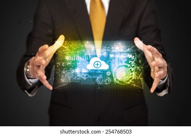 Businessman holding a shining data cloud in front of his body