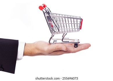 Businessman holding a shopping cart, isolated over white background