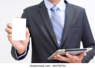 Businessman holding or showing blank business card