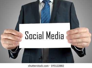 Businessman holding or showing card with social media text