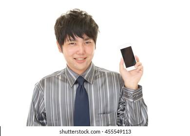 Businessman holding a smart phone