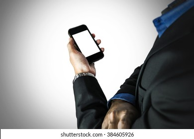 Businessman holding smart phone, with copy space, selective focus