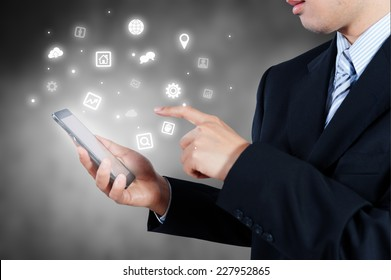 businessman holding smart phone showing icon, business strategy concept