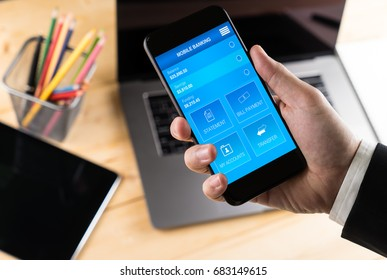 Businessman Holding smart phone to use mobile banking app