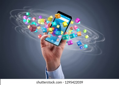 businessman holding a smartphone with icon cubes spinning around
