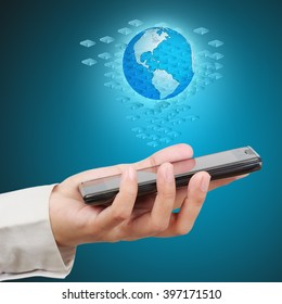Businessman holding a smartphone show innovation concept on virtual screen.