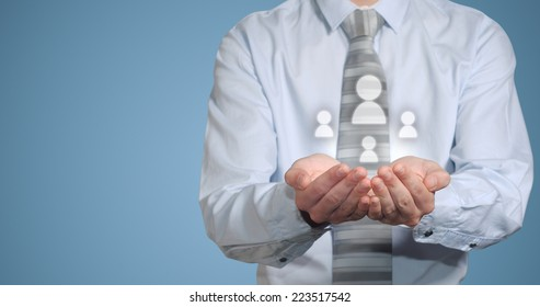 Businessman holding social media people icons in hands