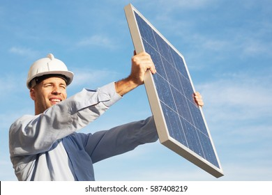 Businessman holding solar panel