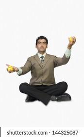 Businessman holding stress balls