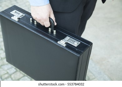 Businessman holding a suitcase