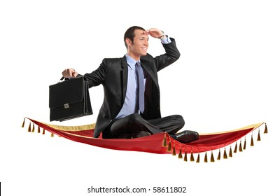A businessman holding a suitcase while flying on a magic carpet