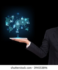 Businessman holding a tablet. Business communication on the network interface to internet and world wide web connection on speed 5 generation. 5G