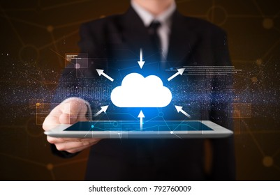 Businessman holding tablet with cloud concept