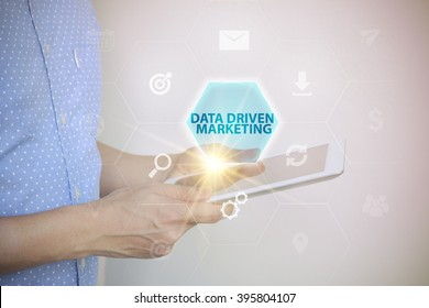 businessman holding a tablet computer with  DATA DRIVEN MARKETING development text