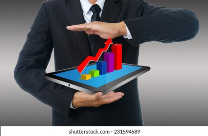 Businessman holding tablet with finance graph for trade stock market, isolated on the white background.