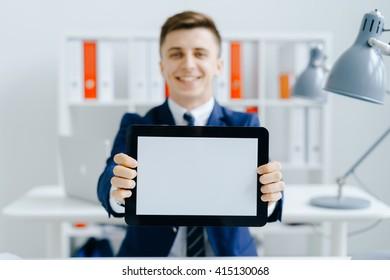 Businessman holding tablet in hands