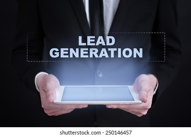 Businessman holding a tablet with a lead generation text. business concept.