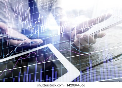 Businessman holding tablet on hand and using electronic pen while working at office.Concept of digital diagram,graph interfaces,virtual screen,connections icon.Wide format          - Image