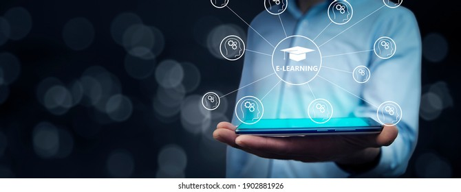 """Businessman holding a tablet pc with """"E-learning"""" text on virtual screen. Business concept."""