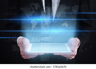 Businessman holding tablet PC with empty space for text. Busines concept.