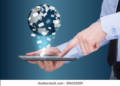 Businessman holding a tablet pc with mobile applications icons on virtual screen . Internet and business concept. message. mail.