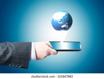 Businessman holding tablet PC screen with blue internet globe and email coming out from the screen. Concept for internet and connectivity