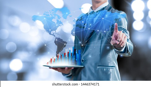 businessman holding tablet report on growth of business virtual chart and globalisation. business strategic planning conceptual.