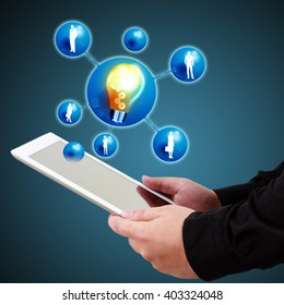 Businessman holding a tablet show innovation concept on virtual screen.