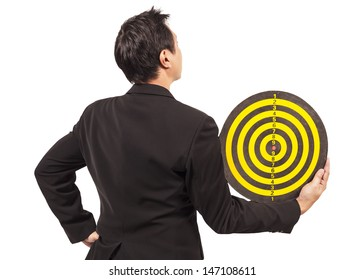 businessman holding target behind on white