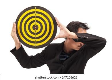 businessman holding target on white