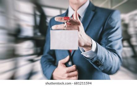 Businessman holding a Trade Fair entrance card on a lanyard