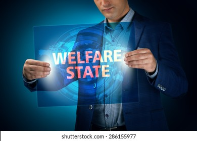 Businessman holding a transparent screen with an inscription a welfare state. Business, technology, internet and networking concept.