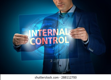 Businessman holding a transparent screen with an inscription a internal control. Business, technology, internet and networking concept.