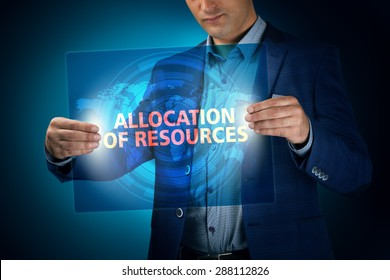 Businessman holding a transparent screen with an inscription a allocation of resources. Business, technology, internet and networking concept.