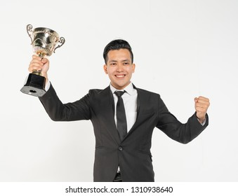 Businessman holding trophy with succesful concept.