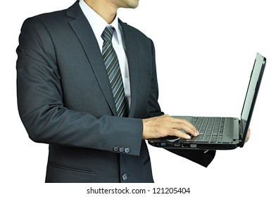 Businessman holding and typing laptop computer