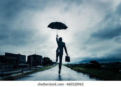 businessman are holding an umbrella