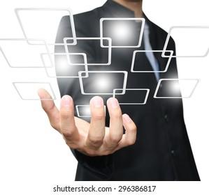 Businessman holding virtual button