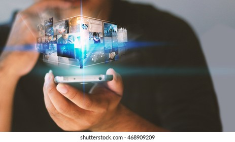 Businessman holding virtual screen.business concept.