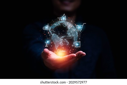 Businessman holding virtual world and technology icons communication working and transaction ,Global  business by internet connection technology for financial banking , big data and digital linkage.