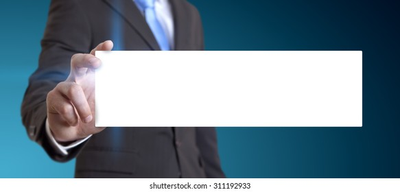 Businessman holding white business card in his hand
